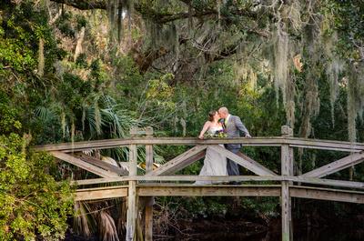 Wedding kiss on bridge